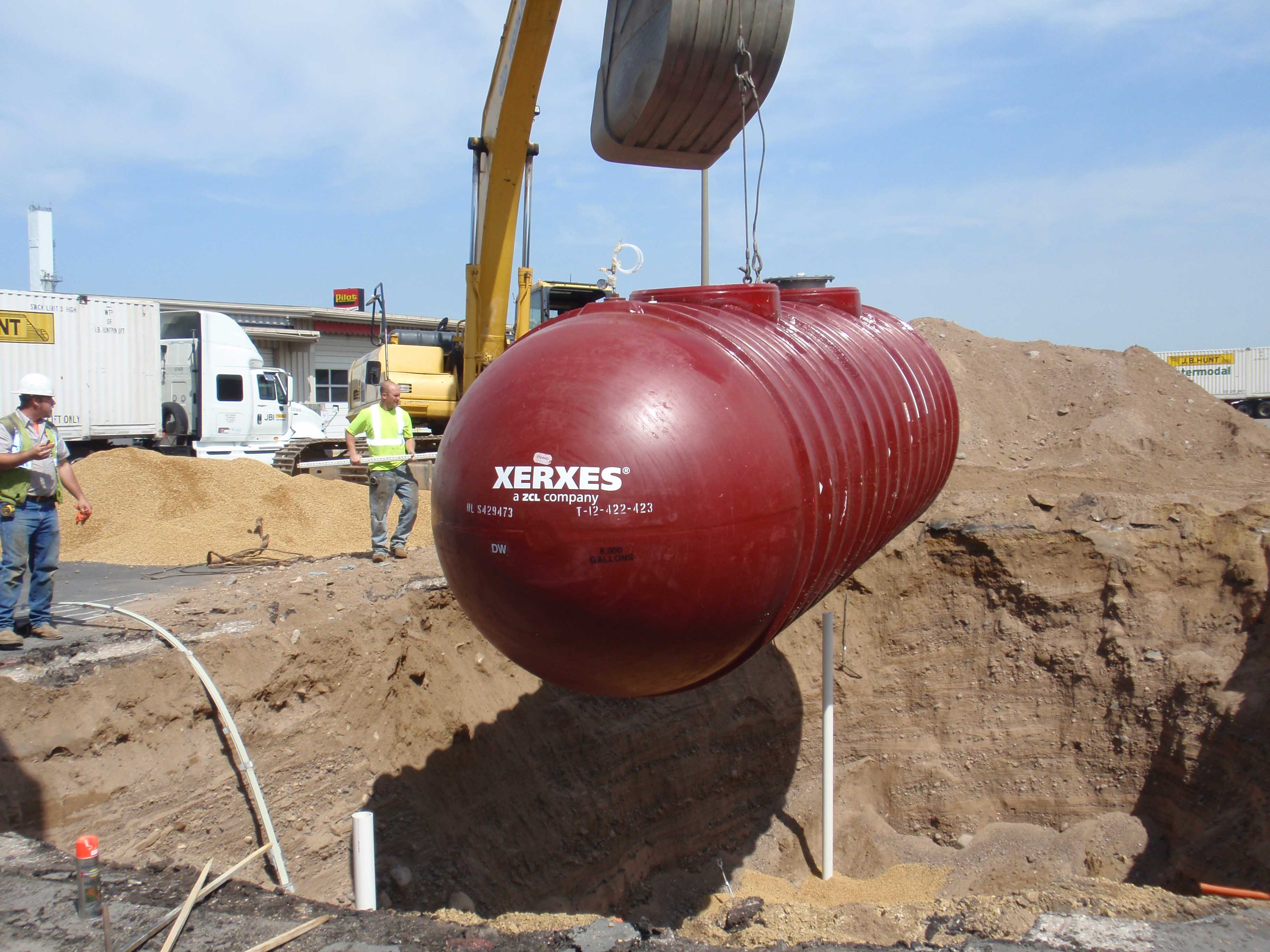 Xerxes Double Wall Fiberglass underground storage tank UST being lowered into ground during tank replacement in Adelanto, CA
